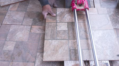 cserepezés : Construction men worker builder cutting tiles at home Stock mozgókép