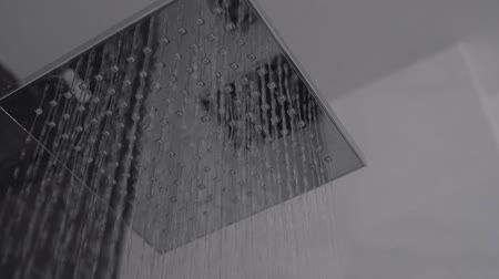dokonalost : close-up  shower flowing slow motion in bathroom