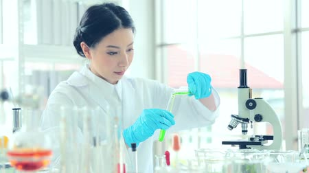 speculate : Closeup Science women students working with chemicals in lab Stock Footage