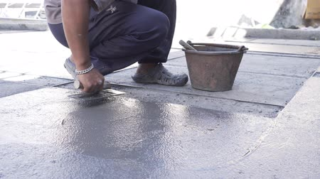 paving : Industry construction man builder washed gravel on floor