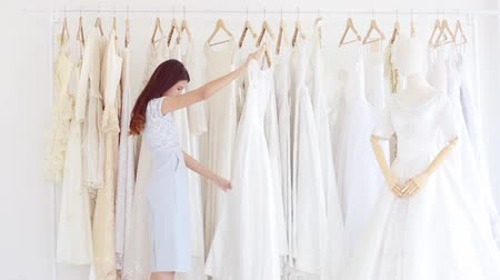 продавщица : Asian designer working in wedding fashion store shop,Friendship congratulations to the wedding