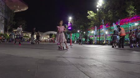 roller blading : NAKHONRATCHASIMA, THAILAND - MARCH 23, 2019:Group of kids playing roller skating on night