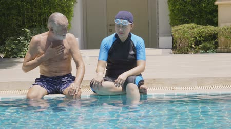異性のカップル : Elderly couple in pool Hollyday Healtthy concept