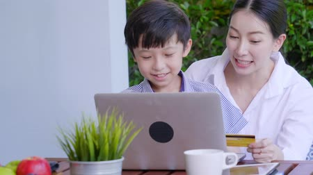 wi fi : Asian family laughing and looking in digital laptop while lying on bed in bedroom