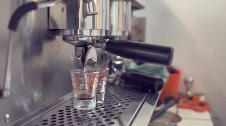 portafilter : Closeup coffee dripping from machine