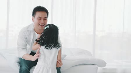 puericultura : Slow motion, Asian little girl running to mother and father hugging in bedroom