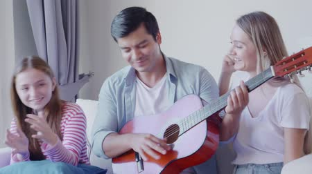 pré escolar : Family time man play guitar in living room Stock Footage
