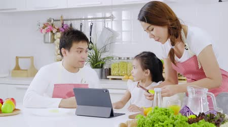 pasu nahoru : Family parent and daughter enjoy eating breakfast in kitchen room