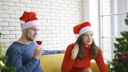 dekoracje : People couple sitting sofa drink wine with christmas day at home