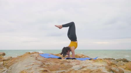 tartmak : Asian woman with a slender practicing yoga on mountain background sky and ocean,Healthy active lifestyle concept
