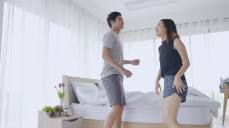 friendship dance : Asian couples dancing in the bedroom happily celebrating