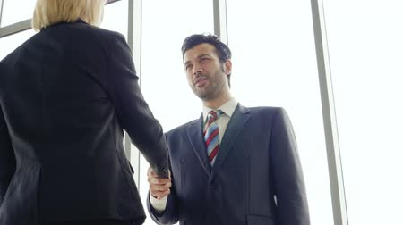 dispatcher : Business success,Businessman and businesswoman stand handshake congratulation job Stock Footage