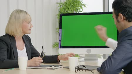 ajánlás : Business teamwork, two business talking report presentation to business colleagues in the conference room, Green screen on desktop Stock mozgókép