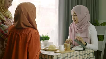 qr : two muslim women eating food and drink in restaurant use scan qr code and payment on mobile phon, Lifestyle technology concept Stock Footage