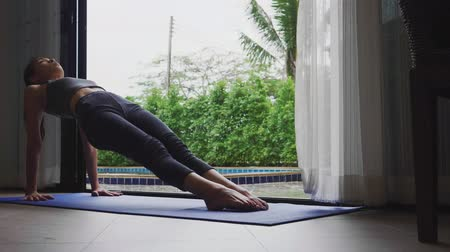 Asian woman with a slender practicing yoga at home,Healthy active lifestyle concept Stok Video