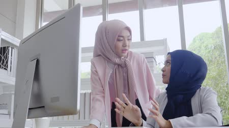 two muslim business women working in office