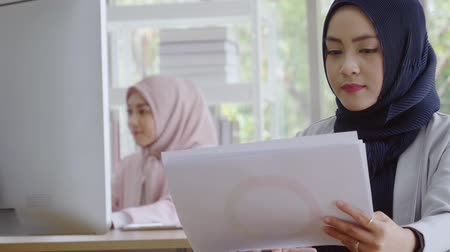 Beautiful Muslim Businesswoman Uses Desktop Computer Working in Office
