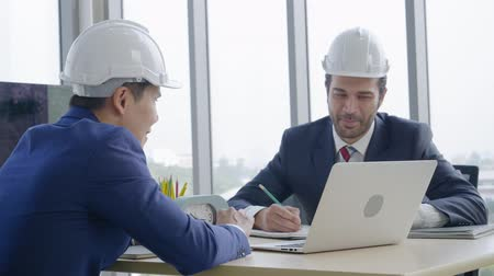 Industry concept,Two engineer businessmen talking planning construction project in office Стоковые видеозаписи