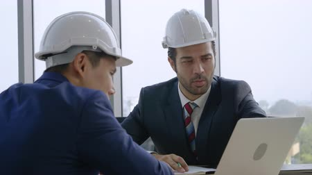 Industry concept,Two engineer businessmen talking planning construction project in office Stok Video