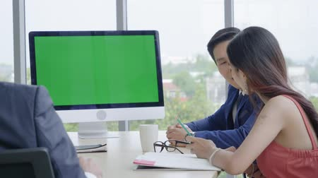 Business teamwork,Businesswomen talking report presentation to business colleagues in the conference room,Green screen on desktop