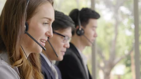 Operator team,Closeup face operator men talking customer service Стоковые видеозаписи