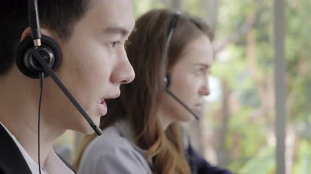 Operator team,Closeup face operator men talking customer service Stok Video