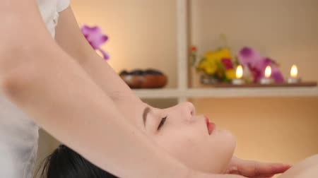 Asian woman relaxing while receiving a massage from a professional masseuse for beauty and health.Professional masseuse massaging back and shoulder of Asian women