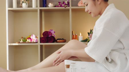Asian woman relaxing receiving oil masseuse for body beauty and health