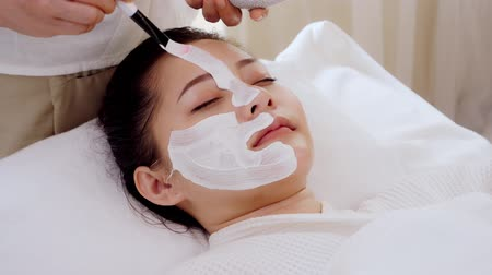 Asian women relax while receiving facial care by applying facial mask with cream,Spa on face