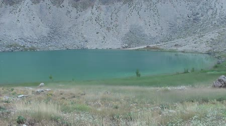 spent : Crater green lake panning Stock Footage