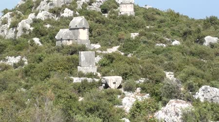 sarcophagus : Simena Tombs on hill zoom out
