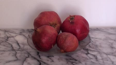 macrobiotic : Pomegranates indoors zoom in