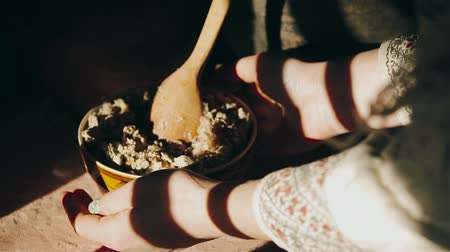 пельмени : Woman takes the pot with food close up