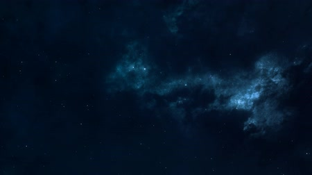 infinito : Space flight in the slightly glowing nebula, tinted with shades of blue. Looped video.