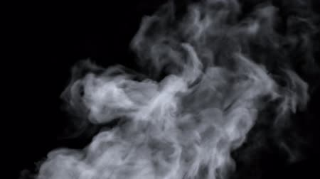 Black background with a fast moving smoke with sharp turbulent areas. Wideo