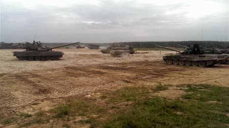 war field : Tanks go and stop at the military training ground in the dust Stock Footage