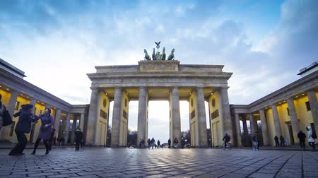 gates : BERLIN, GERMANY - MARCH 4, 2015: People walking near Brandenburg Gate in Berlin, Germany. Brandenburg Gate built between 1788 and 1791 and now is the most famous and well-known landmarks of Germany