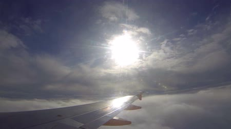 alma : Passenger airplane flights through the clouds. Fast-motion video Stok Video