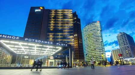 bahnhof : BERLIN, GERMANY - JULY 2, 2014: Evening view of Potsdamer Platz. The new modern city center and financial district of Berlin, Germany. Time Lapse