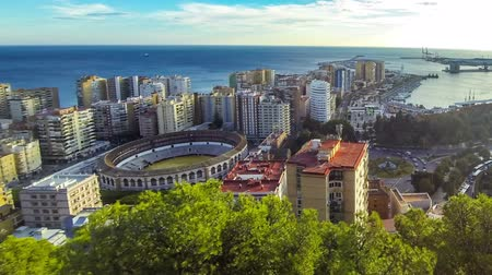 malagueta : Panoramic aerial view of Malaga city, Costa del Sol, Andalusia, Spain. Cityscape of La Malagueta district with port and Toros de Ronda bullring. View from Gibralfaro castle. Tima Lapse