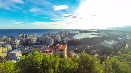 bullfight : Panoramic aerial view of Malaga city, Costa del Sol, Andalusia, Spain. Cityscape of La Malagueta district with port and Toros de Ronda bullring. View from Gibralfaro castle. Time Lapse. 4K UltraHD