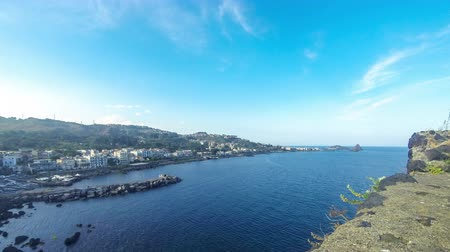 sycylia : Rocky mediterranean coastline near the town of Aci Castello, Sicily, Italy. View from Norman Castle. Cyclops Islands on the background. Time Lapse. 4K UltraHD