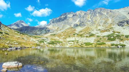 Hiking in High Tatras Mountains, Slovakia. Lake over Skok waterfall (Slovak: Pleso nad Skokom) (1801m). Mounts Satan (2421m), Predna Basta (2374m), Mala Basta (2288m) on the background. Time Lapse