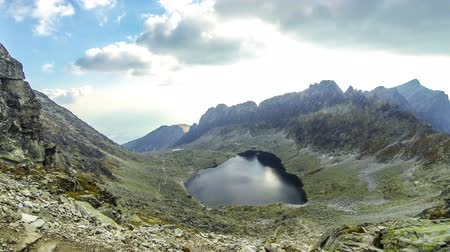 Hiking in High Tatras Mountains, Slovakia. Vysne Wahlenbergovo Pleso Lake (2154m). Mounts Ostra (2351m) on the background. Time Lapse