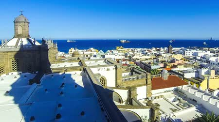Panorama of the city of Las Palmas de Gran Canaria, Canary Islands, Spain. Aerial view from belltower of the Cathedral of Santa Ana. Beautiful seascape and old town on the background. Time Lapse Stok Video