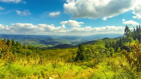 Picturesque landscape of Carpathian mountains in early autumn. View from mount Pikui (1405m), Carpathians, Ukraine. Time Lapse