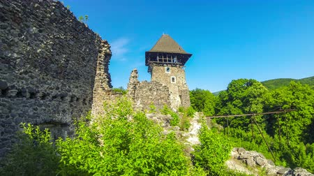 bástya : Nevytske Castle, semi-ruined castle in Zakarpattia Oblast, Ukraine. Located 12 kilometres north of Uzhhorod city. First mentioned in 1274 year. Time Lapse. 4K FullHD video Stock mozgókép