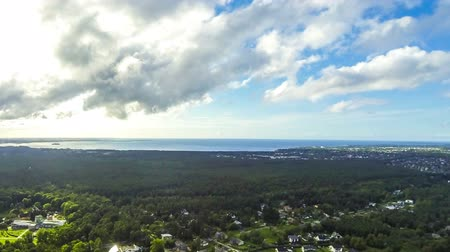 Aerial drone view of beautiful green nature landscape of the outskirts of Tallinn city, Estonia. Tallinn bay of Baltic sea on the background. Time Lapse. FullHD video