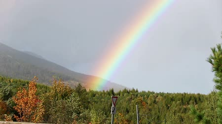 Beautiful rainbow over woods at Vysoke Tatry town in High Tatras mountains, Slovakia. FullHD video