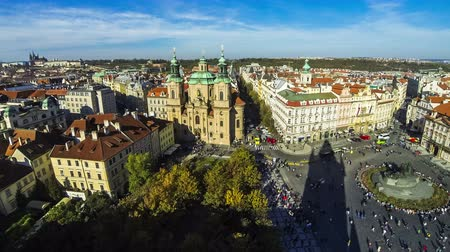 namesti : Aerial view of Saint Nicholas Church (Czech: Kostel Svateho Mikulase) and Old Town Square (Staromestske namesti) in Prague city, Czech Republic. Time Lapse. 4K UltraHD video